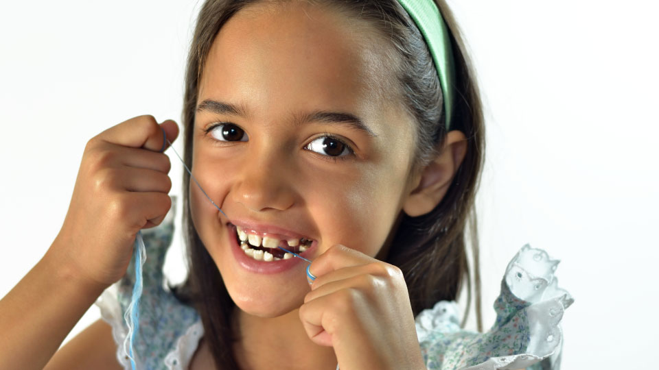 Should Your Child Floss Their Teeth - Drake Family Dentistry
