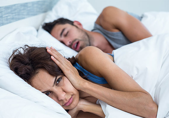 Is Your Bed Partner Keeping You Up Featured Image - Drake Family Dentistry